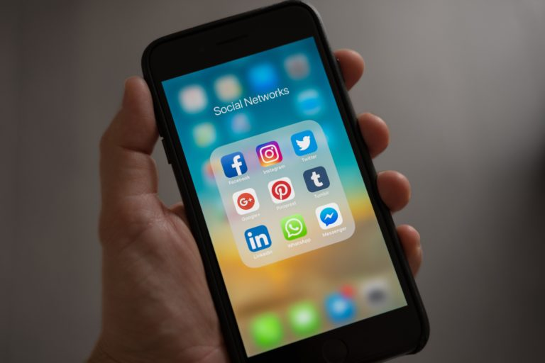 mobile phone screen with social media app icons