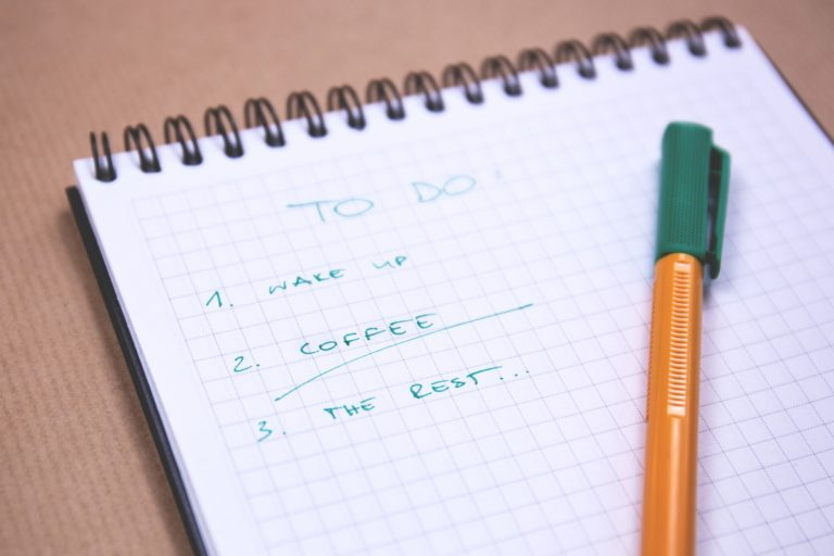 a to-do list with a pen