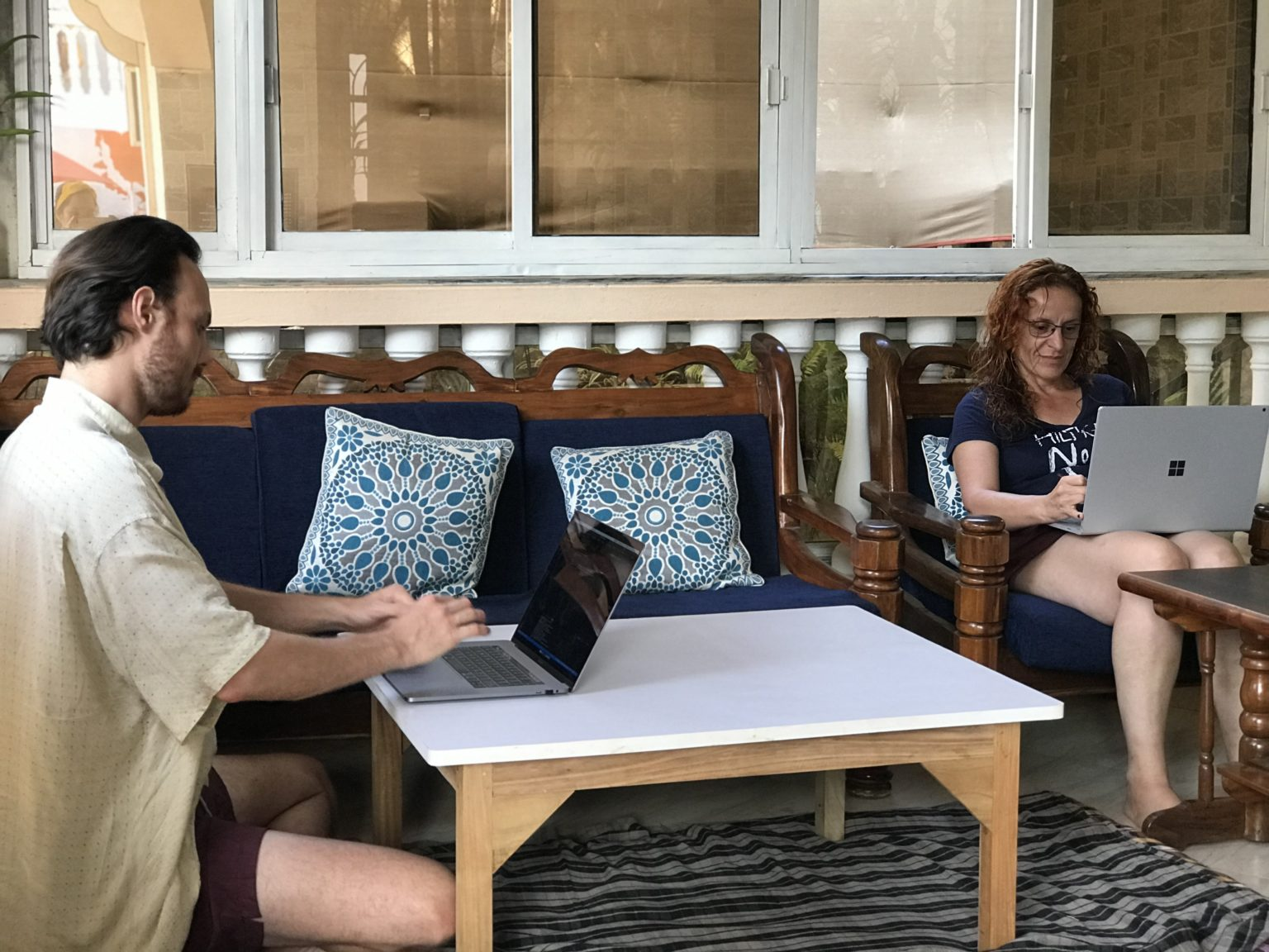 coworking at Nomadgao has been a wonderful experience for many digital nomads a picture of two people coworking from thei own comfortable spots