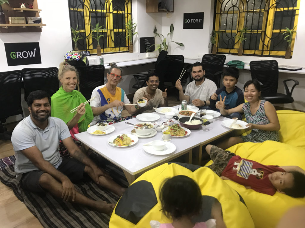 digital nomads eating together at a community event for remote workers in the coliving space